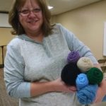 photo of volunteer with yarn