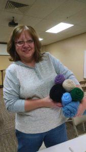 photo of volunteer with yarn