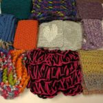 photo of 10 knitted scarves